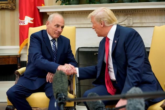 President Donald Trump shakes hands with John Kelly after he was sworn in as White House Chief of Staff...