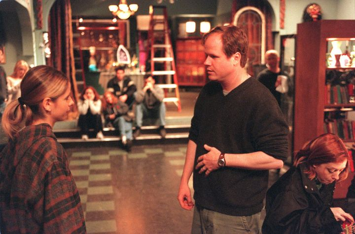 "Whedon on the ""Buffy The Vampire Slayer"" set with actress Sarah Michelle Gellar in 2001."