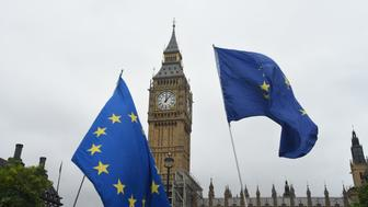 Anti Brexit demonstrators are seen waving European Union flags against the backdrop of the Big Ben, London on August 21, 2017. The UK government has set out proposals to ensure trade in goods and services can continue on the day the UK leaves the EU in March 2019.  (Photo by Alberto Pezzali/NurPhoto via Getty Images)