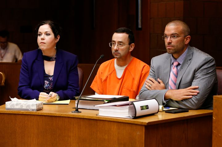 Larry Nassar (C) in court with defense attorneys Shannon Smith (L) and Matt Newberg (R) where Judge Donald Allen Jr. bound hi