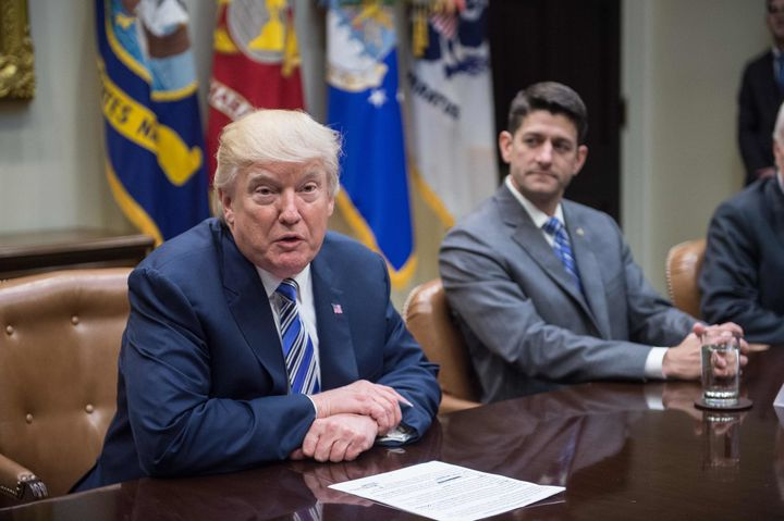 House Speaker Paul Ryan, right, released a statement condemning white supremacists, but not calling out statements on the mat
