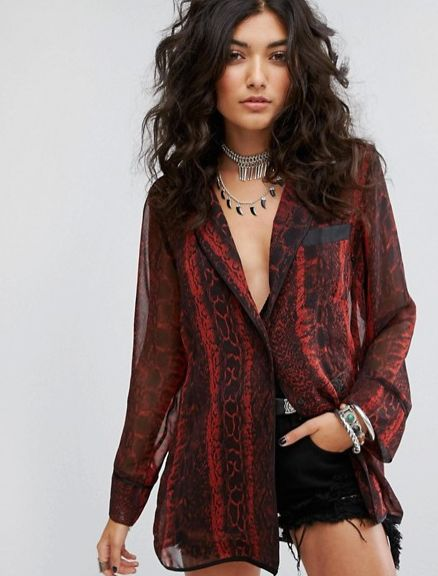 "<a href=""http://us.asos.com/sacred-hawk/sacred-hawk-exaggerated-silky-pajama-shirt/prd/8342485?clr=redsnake&SearchQuery=p"