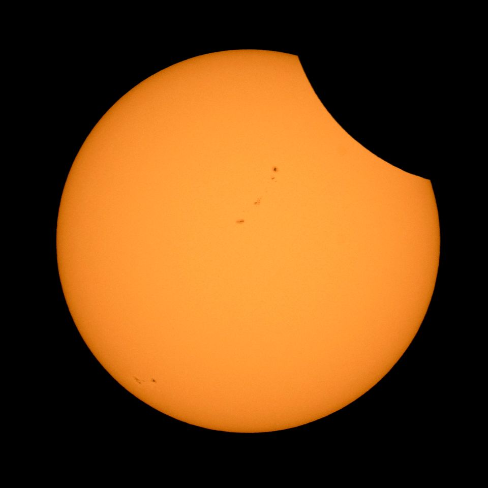 The Moon is seen as it starts passing in front of the Sun during the solar eclipse August 21, 2017 from Ross Lake, North Casc