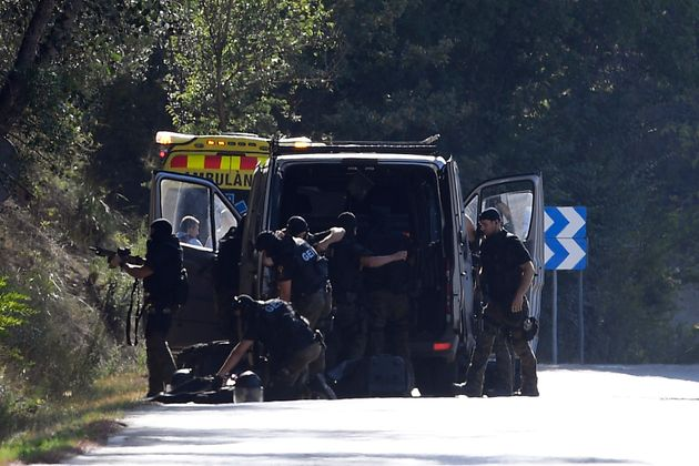 Police on the site where Moroccan suspect Younes Abouyaaqoub was shot