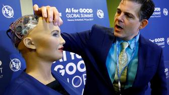 "David Hanson of Hanson Robotics presents Sophia, a robot integrating the latest technologies and artificial intelligence, during a presentation at the ""AI for Good"" Global Summit at the International Telecommunication Union (ITU) in Geneva, Switzerland June 7, 2017. REUTERS/Denis Balibouse"