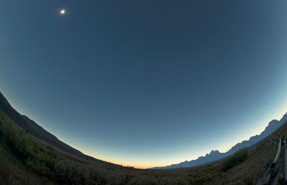 The sun is is in full eclipse over Grand Teton National Park outside Jackson, Wyoming.
