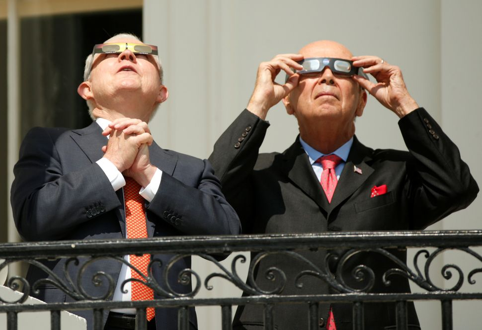 Attorney General Jeff Sessions, left, and Commerce Secretary Wilbur Ross watch from the White House.