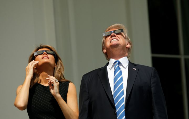 U.S. President Donald Trump and Melania Trump watch the solar eclipse from the White House.