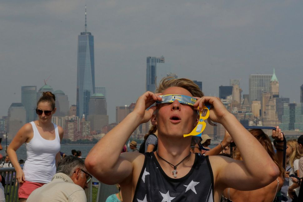 A man takes a look at the solar eclipse at Liberty State Island in New York.