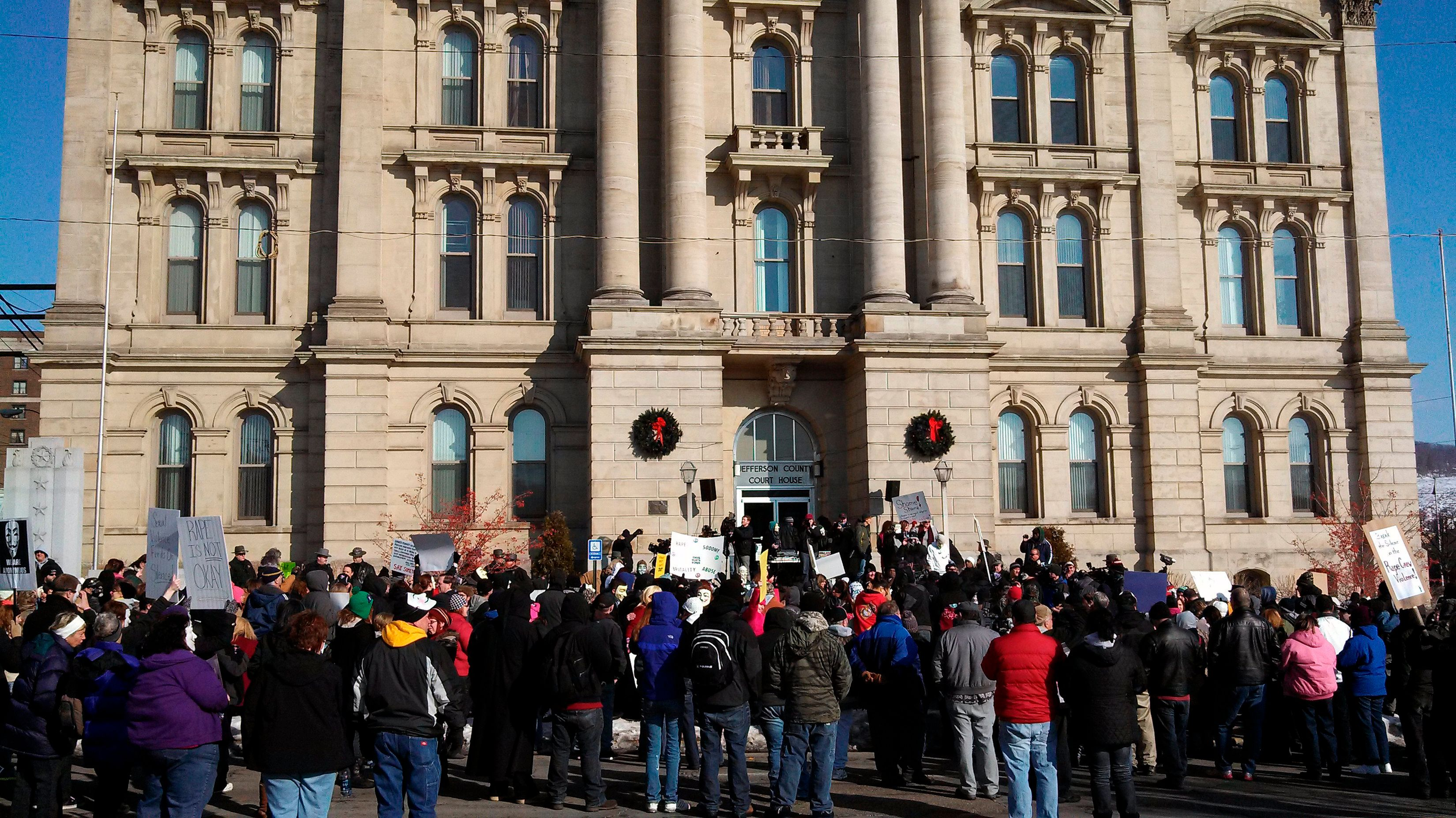 Protesters upset by the local sheriff's handling of a rape case involving two high school football players gathered in front
