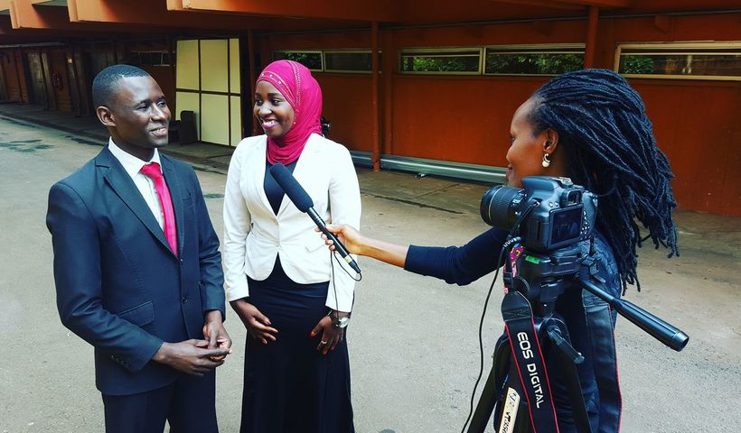 Media Challenge Initiative trainee, Allen Mukiza, conducting an interview.