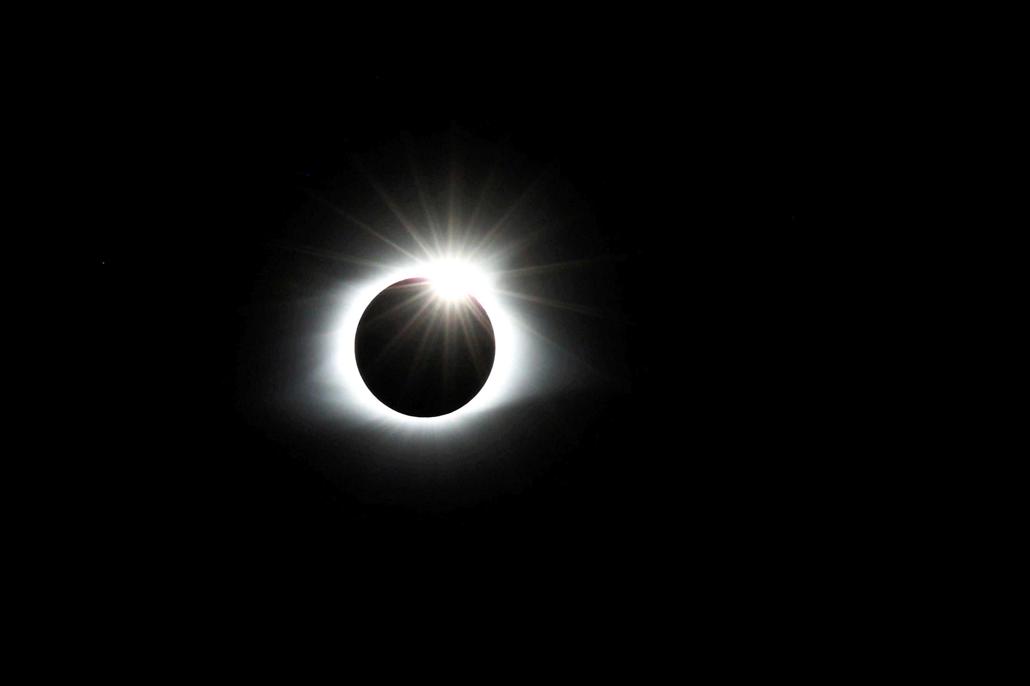 """The solar eclipse creates the effect of a diamond ring at totality as seen from Clingmans Dome, which at 6,643 feet (2,025m) is the highest point in the Great Smoky Mountains National Park, Tennessee, U.S. August 21, 2017. Location coordinates for this image are 35º33'24"""" N, 83º29'46"""" W. REUTERS/Jonathan Ernst     TPX IMAGES OF THE DAY"""