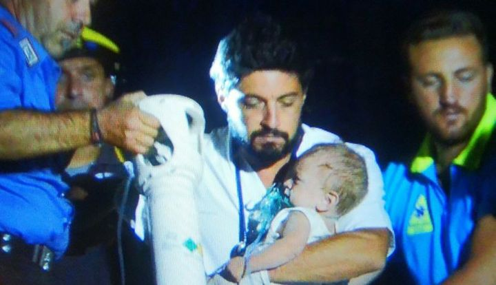 Rescuers cheered as they pulled a baby from the rubble
