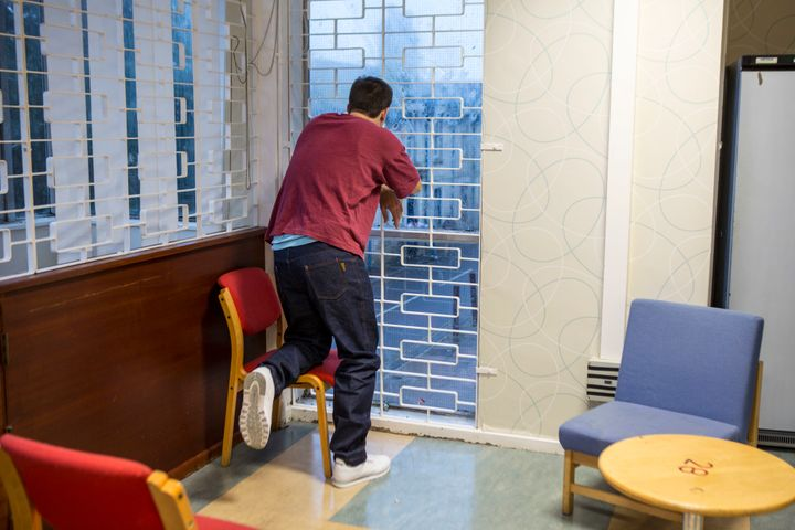 A prisoner watches his family leave after a visit. HMP/YOI Portland, Dorset.
