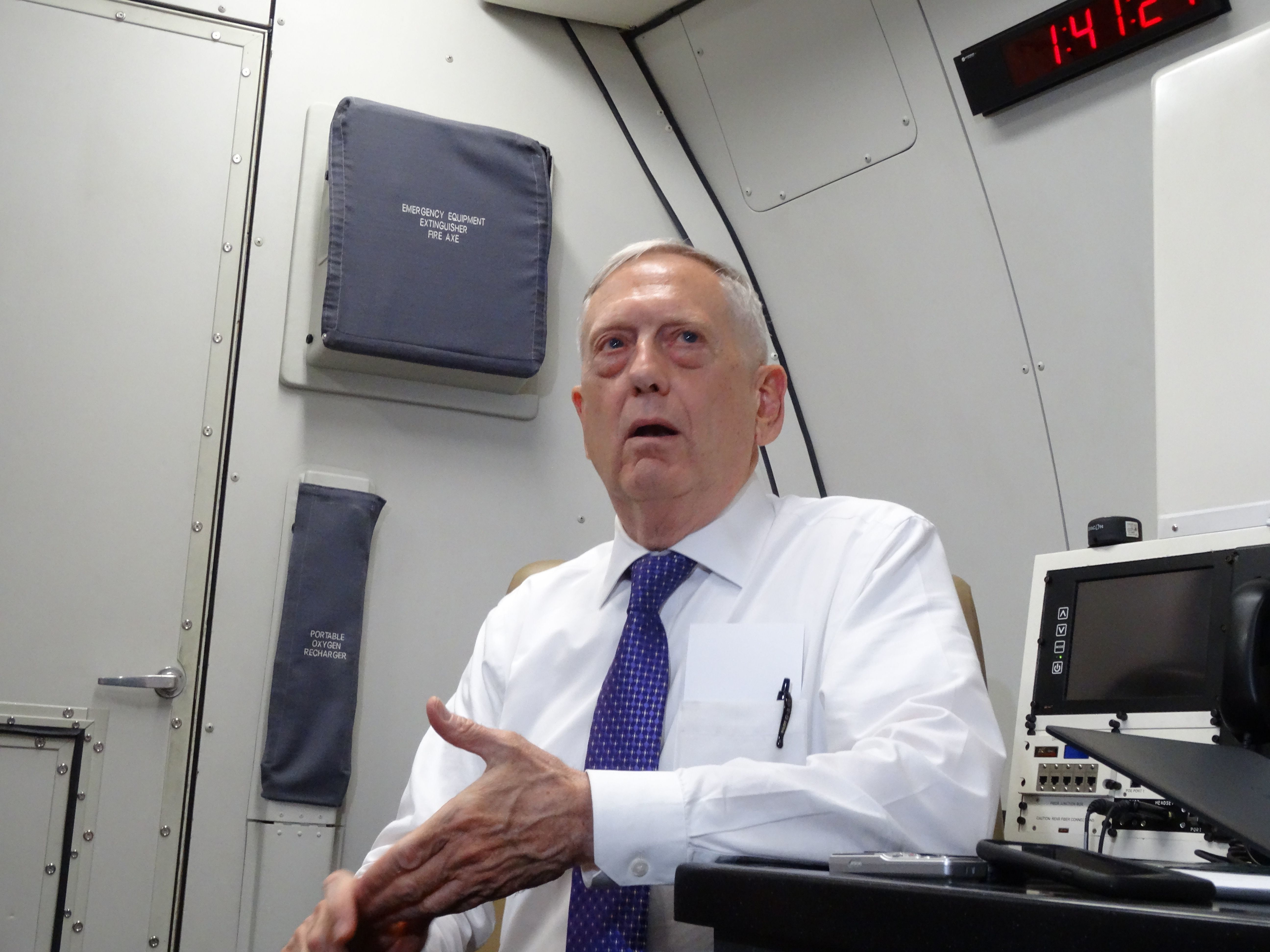 US Defense Secretary James Mattis speaks to reporters on board a flight to Jordan for the start of a regional tour on August 20, 2017.  / AFP PHOTO / Paul HANDLEY        (Photo credit should read PAUL HANDLEY/AFP/Getty Images)