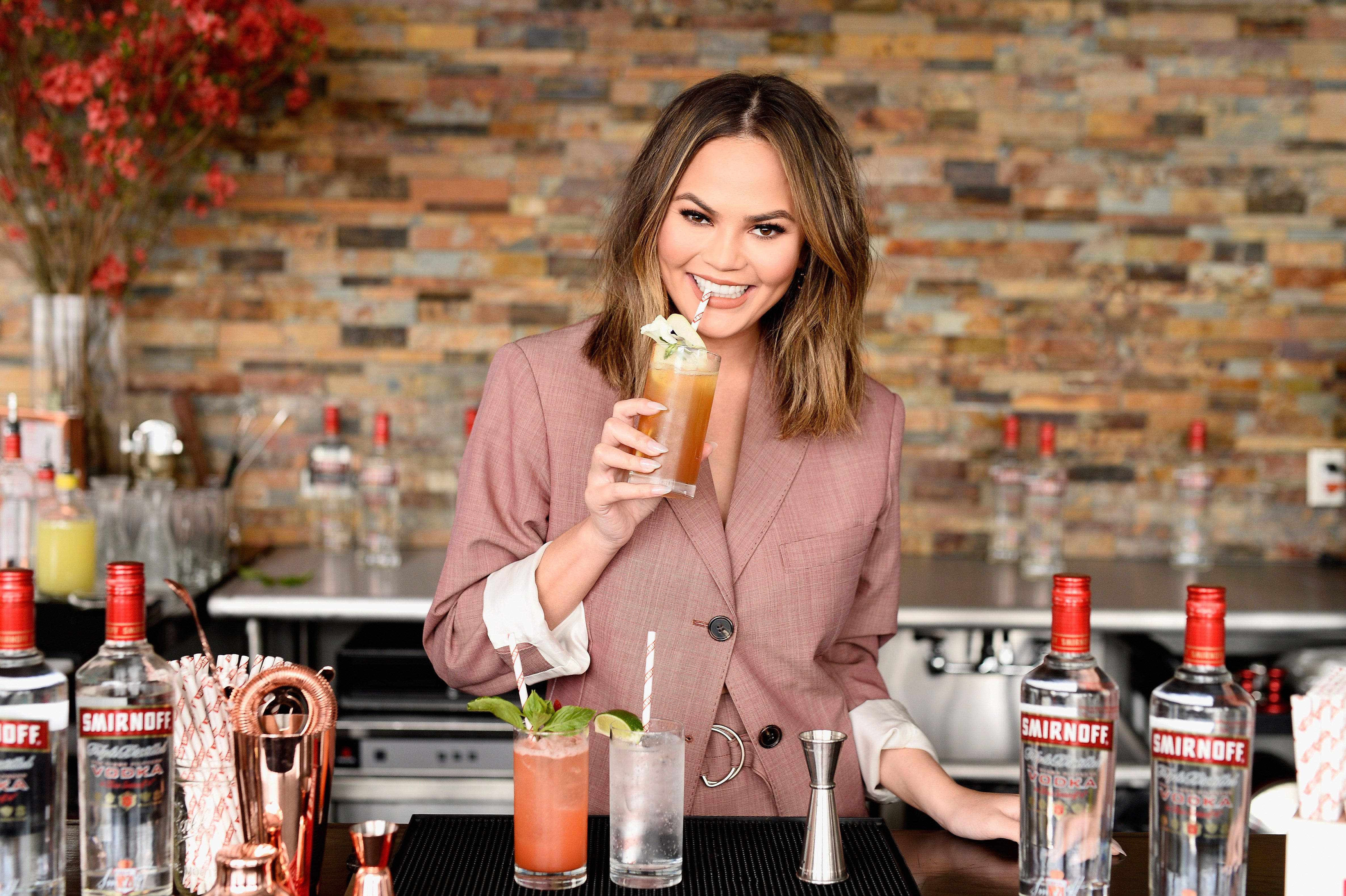 Chrissy Teigen hosts a 'Cocktails with Chrissy' with Smirnoff.
