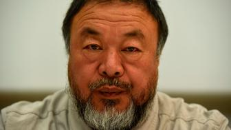 Chinese artist Ai Weiwei poses before a press conference at Proa Foundation in La Boca neighbourhood, Buenos Aires, on August 1, 2017.  Weiwei's first anthological exhibition in Latin America will be inaugurated on 18 November,2017 at Proa Foundation in the Argentinian capital. / AFP PHOTO / EITAN ABRAMOVICH        (Photo credit should read EITAN ABRAMOVICH/AFP/Getty Images)