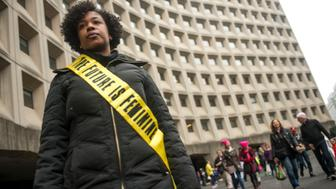 WASHINGTON, DISTRICT OF COLUMBIA - JANUARY 21: Manique Beckman shows off her protest sash as she makes her way to the rally at the Women's March on Washington on January 21, 2017 in Washington, DC. (Photo by Ann Hermes/The Christian Science Monitor via Getty Images)