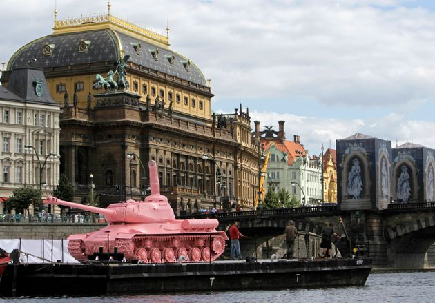 A pink Soviet World War II-era tank on display in front of the National Theatre in Prague on June...