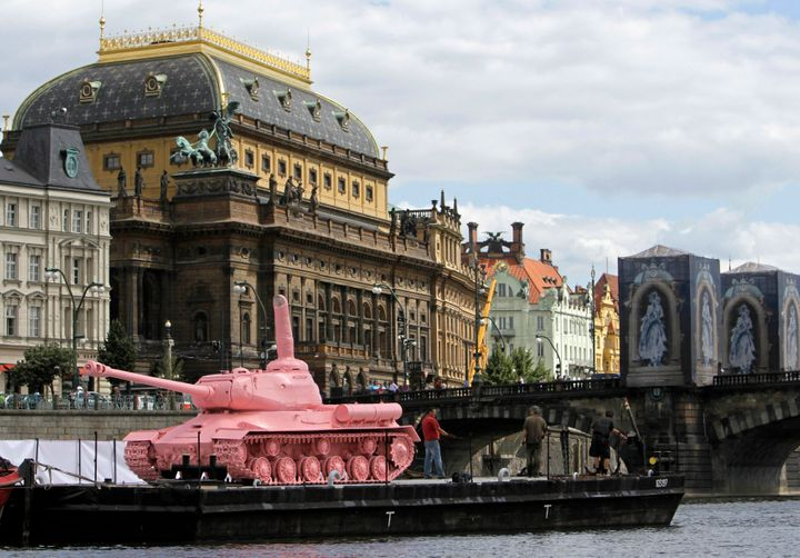 A pink Soviet World War II-era tank on display in front of the National Theatre in Prague on June 20, 2011, marking the