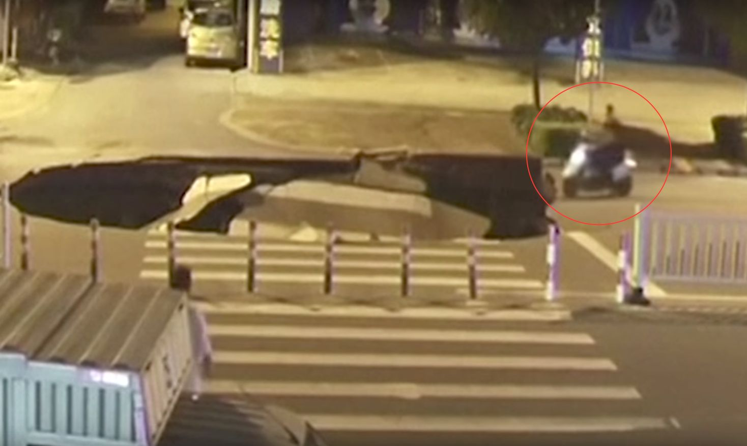 Scooter Plunges Straight Into A Sinkhole After It Opens In A