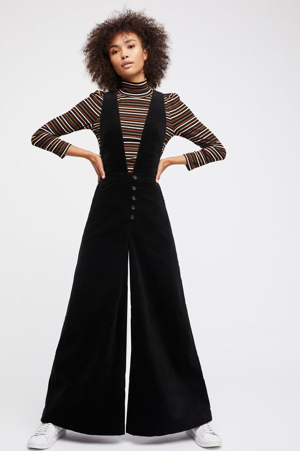 """<a href=""""https://www.freepeople.com/shop/old-school-love-jumpsuit/?color=001"""" target=""""_blank"""">Shop Free People now</a>."""