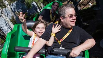 CARLSBAD, CA - FEBRUARY 06:  Actor/comedian Patton Oswalt (R) and his daughter Alice Oswalt ride The Dragon roller coaster at LEGOLAND on February 6, 2016 in Carlsbad, California.  (Photo by Daniel Knighton/Getty Images)