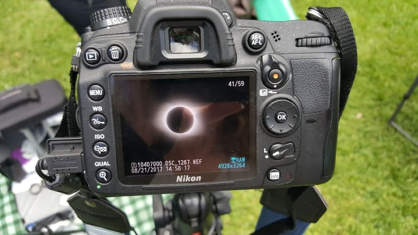 Phone snap of Linda Joy's Nikon's viewing monitor showing the glowing ring of the sun.