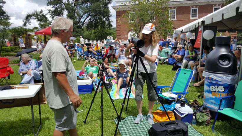 Science writer and amateur photographer Linda Joy sets up her camera for a once-in-a-lifetime photo op.