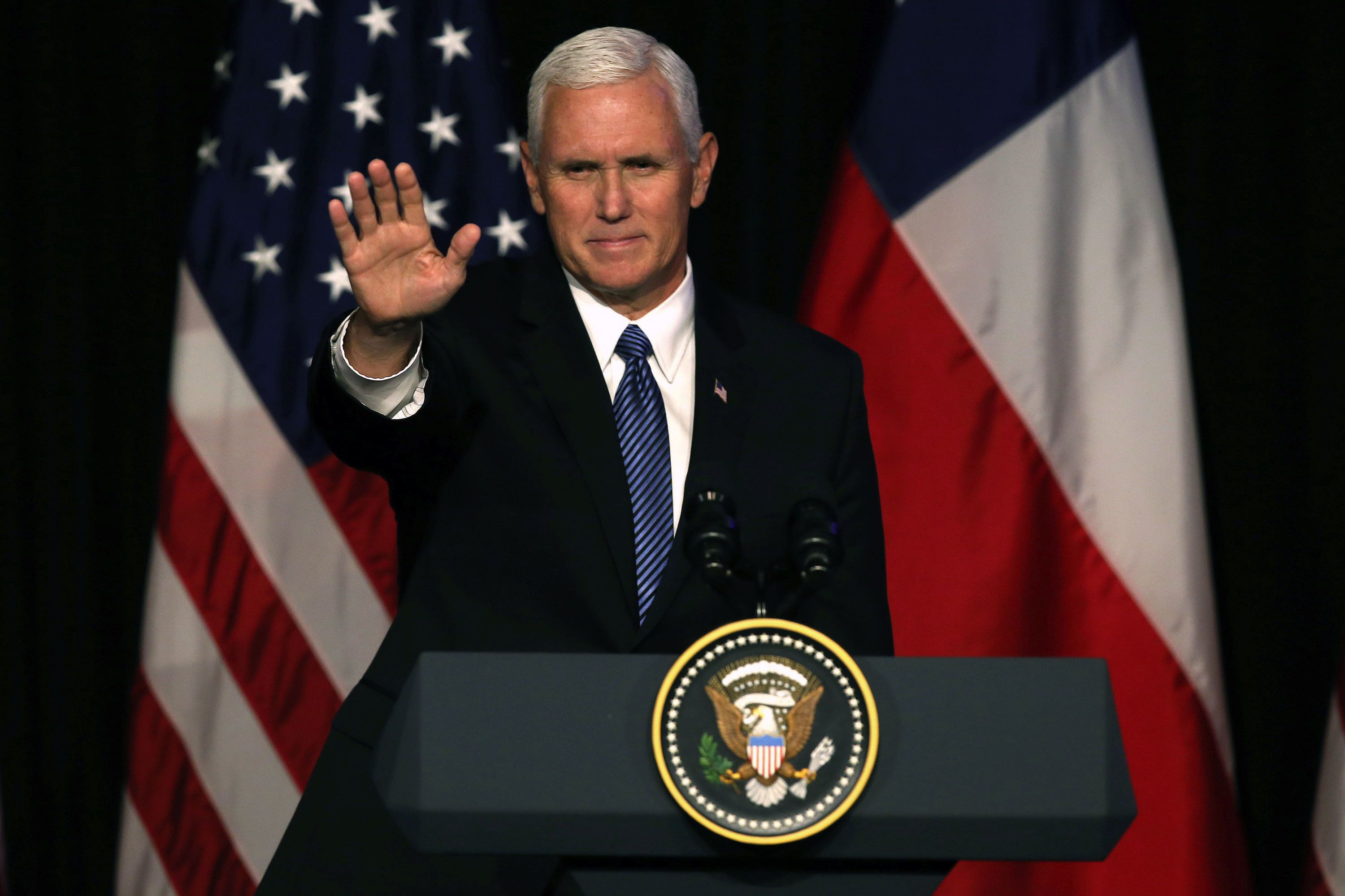 Vice President of the United States, Mike Pence, gestures as he delivers a speech during a business dinner in Santiago, on August 16, 2017.  Pence arrives in Santiago to begin a two-day visit to Chile that is part of his first tour in Latin America. / AFP PHOTO / CLAUDIO REYES        (Photo credit should read CLAUDIO REYES/AFP/Getty Images)