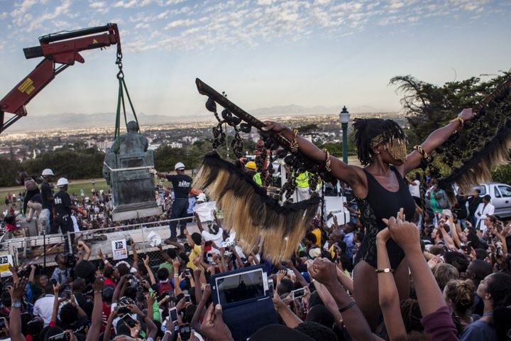 Students cheer as the Cecil Rhodes statue is removed from the University of Cape Town on April 9, 2015, in Cape Town, South A