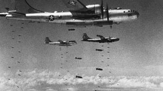 (Original Caption) America Defends Her Freedom - An Armed Forces Day Historical Feature. US Air Force Superfortresses drop their bomb loads on a strategic target during the Korean conflict. These B-29's also played a major role in the final victory against the Japanese in WWII. (Photo by © Hulton-Deutsch Collection/CORBIS/Corbis via Getty Images)