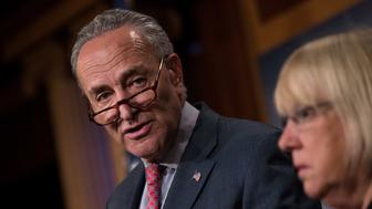 NEW YORK, NY - JUNE 26: (L to R) Senate Minority Leader Chuck Schumer (D-NY) speaks as Sen. Patty Murray (D-WA) looks on during a press conference about the Senate Republican health care bill, on Capitol Hill, June 26, 2017 in Washington, DC. According to the Congressional Budget Office report released on Monday, the Senate GOP health care bill could result in 22 million fewer Americans with health insurance. (Photo by Drew Angerer/Getty Images)