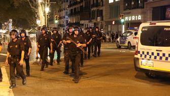 Armed Catalonian Mosses de Escuadra officers leave the area where a van crashed into pedestrians at Las Ramblas in Barcelona, Spain, August 18, 2017. REUTERS/Sergio Perez