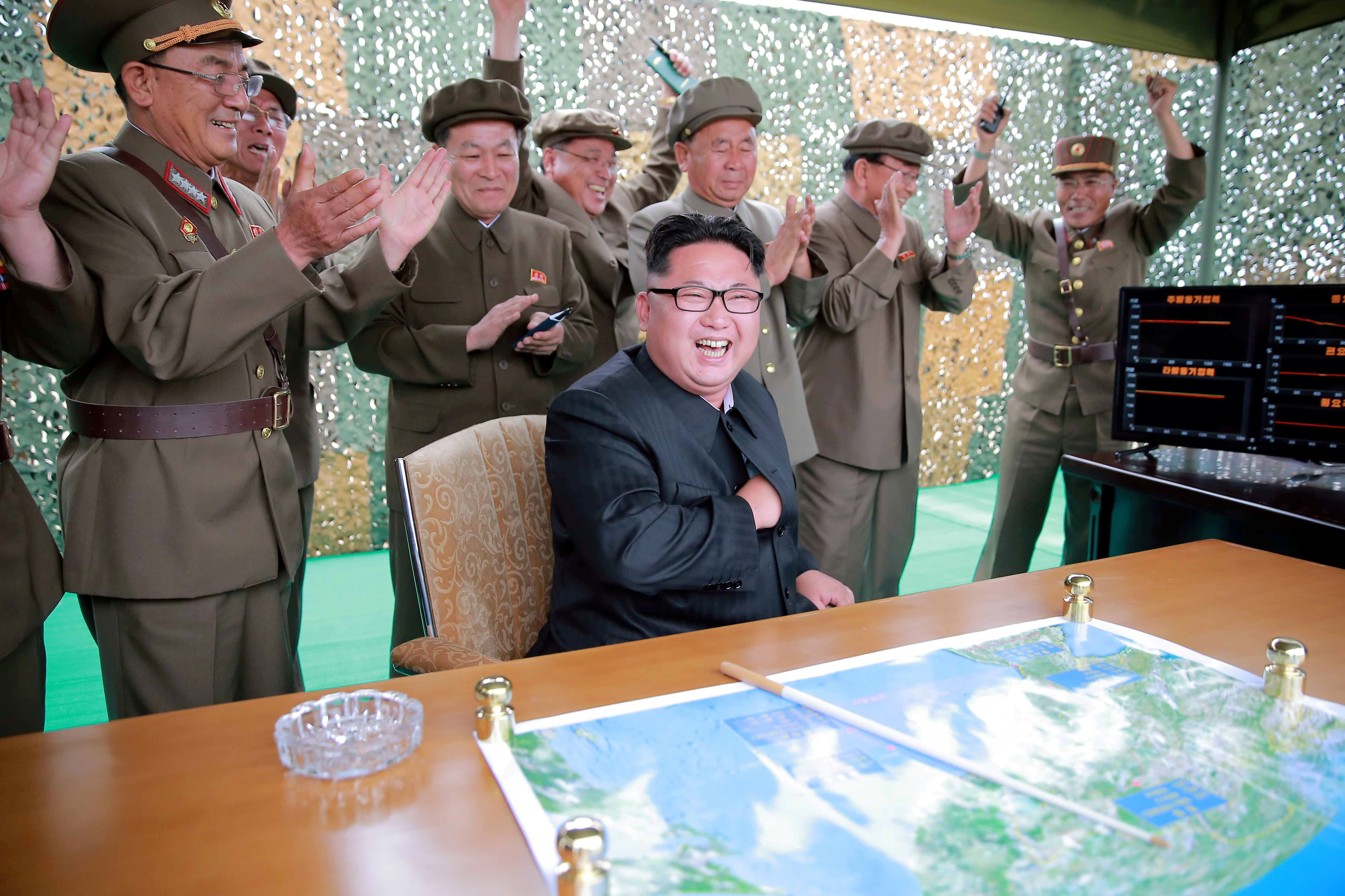 FILE PHOTO: North Korean leader Kim Jongun reacts during a test launch of ground-to-ground medium long-range ballistic rocket Hwasong-10 in this undated photo released by North Korea's Korean Central News Agency (KCNA) on June 23, 2016.  REUTERS/KCNA/File Photo          ATTENTION EDITORS - THIS PICTURE WAS PROVIDED BY A THIRD PARTY. REUTERS IS UNABLE TO INDEPENDENTLY VERIFY THE AUTHENTICITY, CONTENT, LOCATION OR DATE OF THIS IMAGE. FOR EDITORIAL USE ONLY. NOT FOR SALE FOR MARKETING OR ADVERTISING CAMPAIGNS. NO THIRD PARTY SALES. NOT FOR USE BY REUTERS THIRD PARTY DISTRIBUTORS. SOUTH KOREA OUT. NO COMMERCIAL OR EDITORIAL SALES IN SOUTH KOREA. THIS PICTURE IS DISTRIBUTED EXACTLY AS RECEIVED BY REUTERS, AS A SERVICE TO CLIENTS.