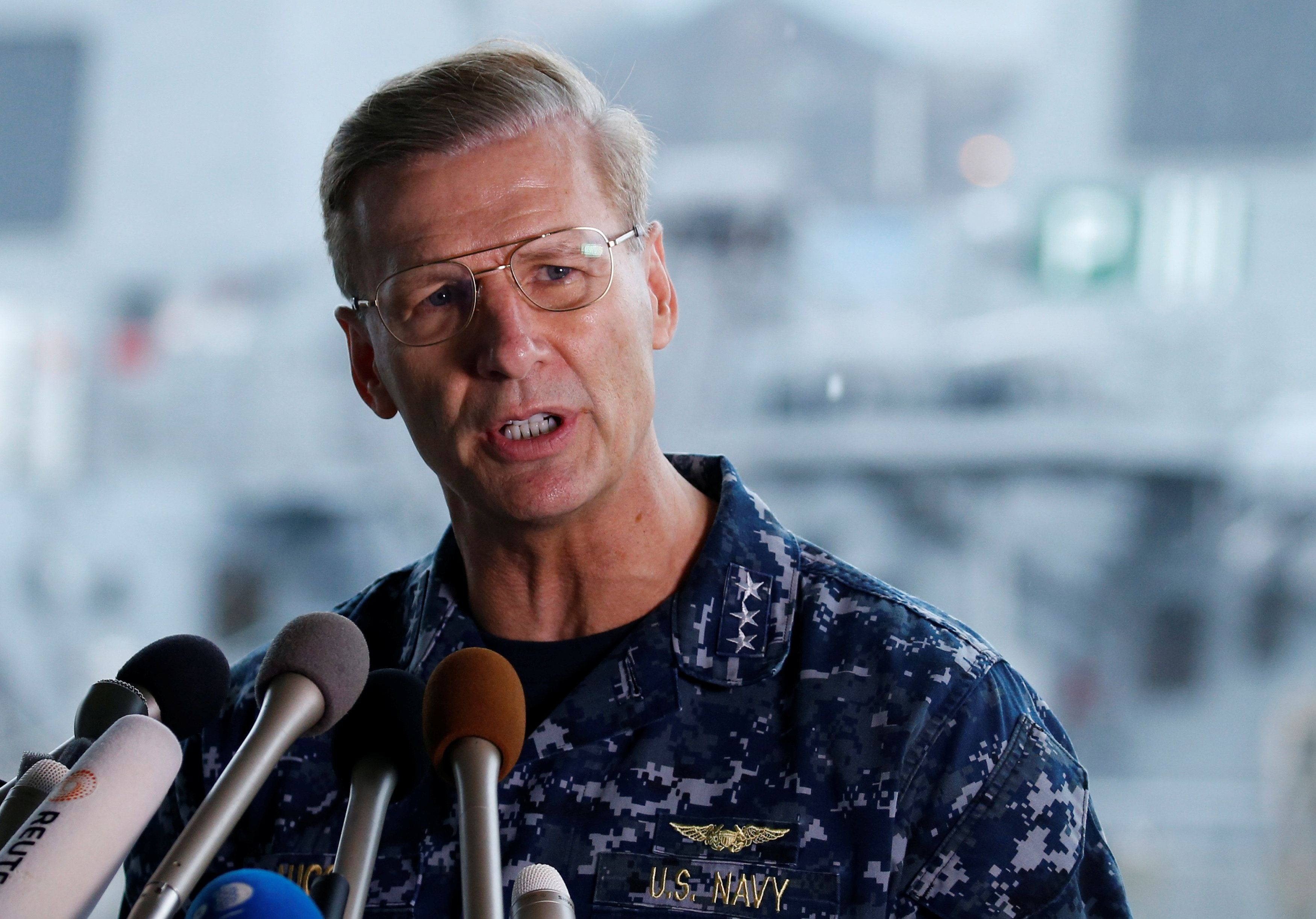 Vice Admiral Joseph Aucoin, U.S. 7th Fleet Commander, speaks to media on the status of the U.S. Navy destroyer USS Fitzgerald, damaged by colliding with a Philippine-flagged merchant vessel, and the seven missing Fitzgerald crew members, at the U.S. naval base in Yokosuka, south of Tokyo, Japan June 18, 2017. REUTERS/Toru Hanai