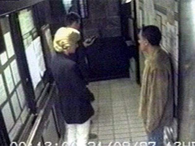Diana and Fayedin the lobby of the hotel at around 00.12 as they prepare to