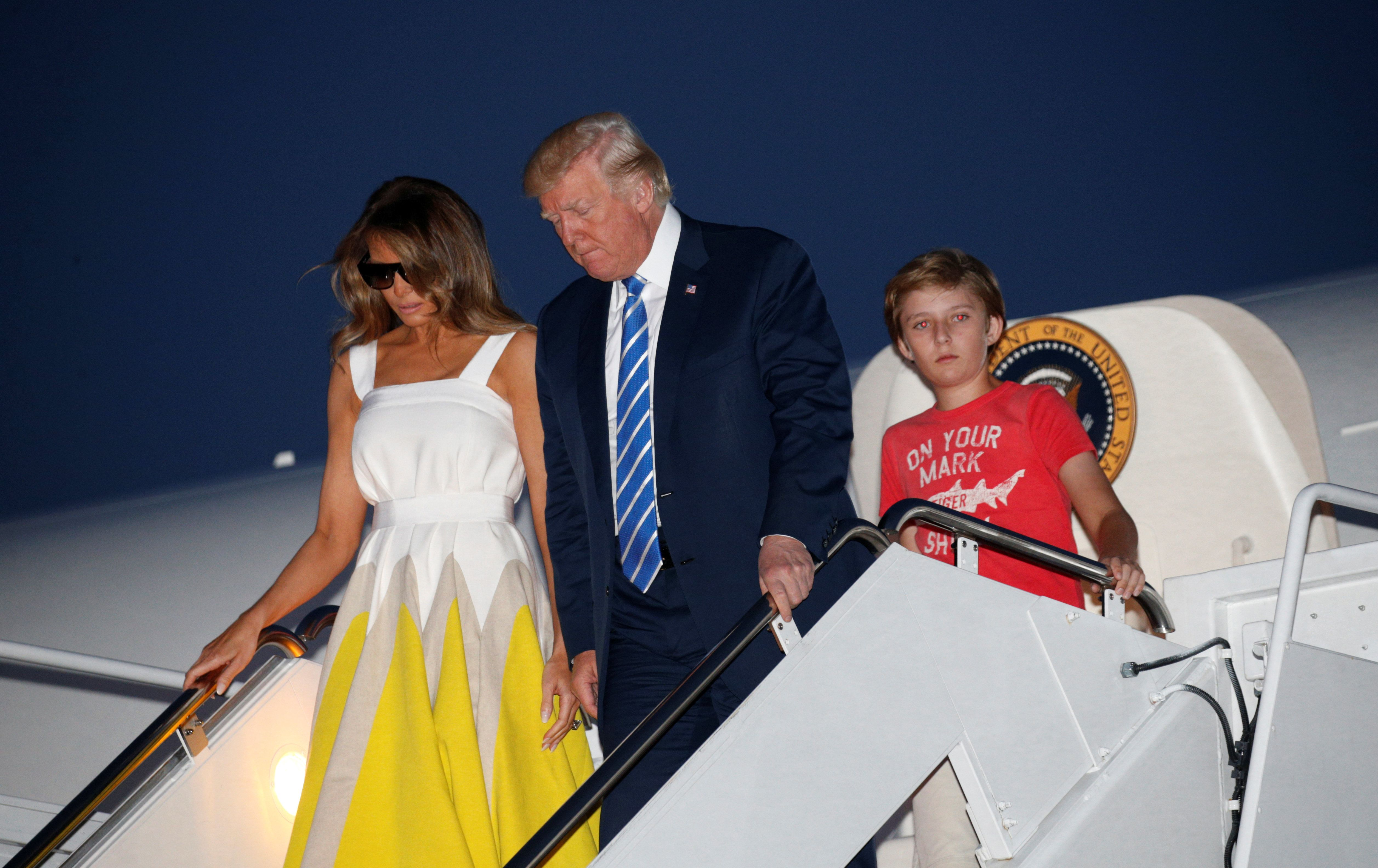 President Donald Trump arrives at Joint Base Andrews with his wife, Melania, and son Barron on Sunday.