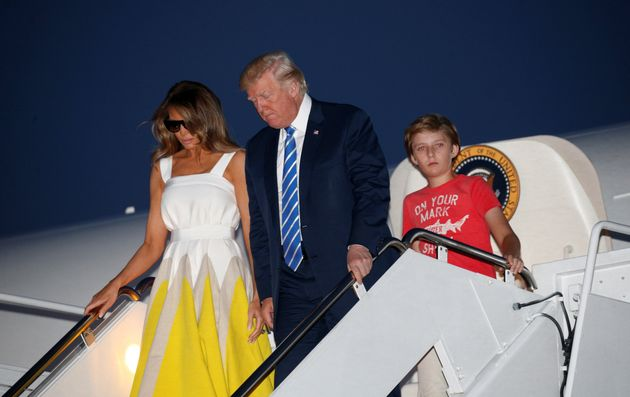 President Donald Trump arrives at Joint Base Andrews with his wife, Melania, and son Barron on