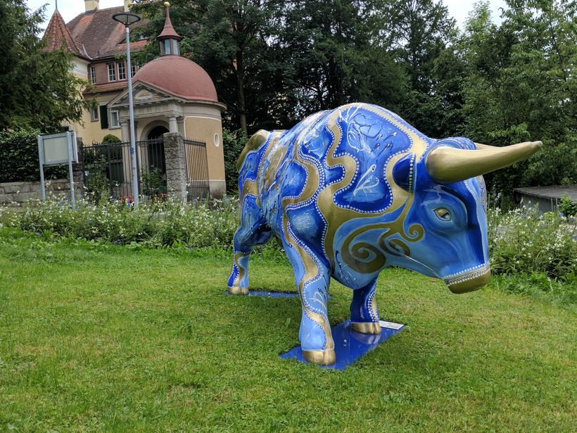 Perhaps meant to mimic New York's Wall Street, a statue of a bull sits in front of a historic building in Zug, Switzerland. Z