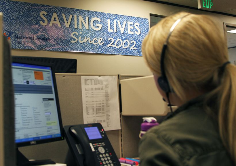 <strong>A tobacco cessation coach speaks to a quitline caller at National Jewish Health in Denver, Colorado, the largest non-