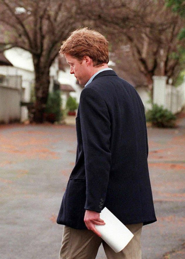 Princess Diana's brother, Earl Spencer turns away from the press after reading a brief statement about...
