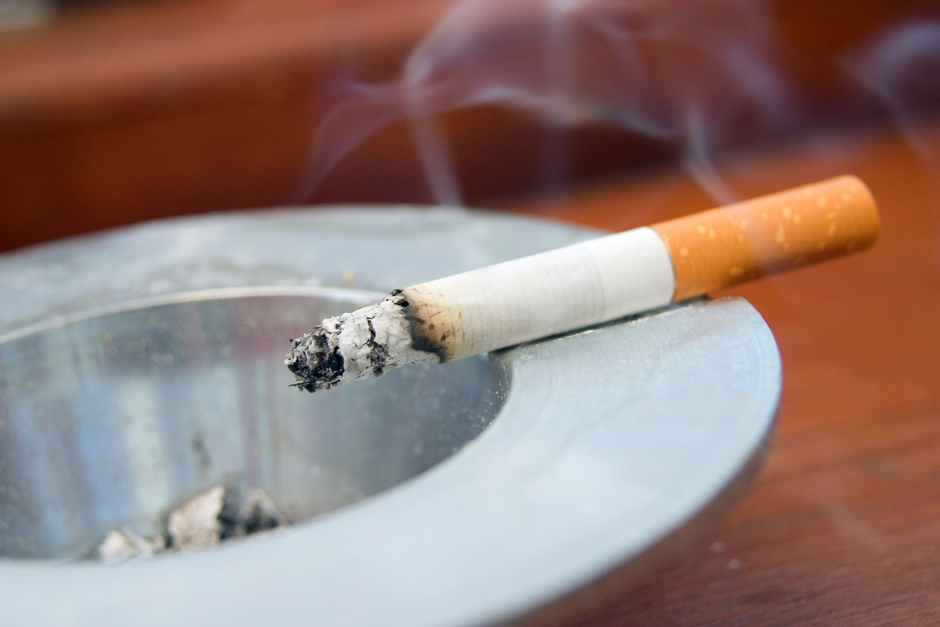 Burning cigarette smoking on ashtray---------------------Similar Images---------------------