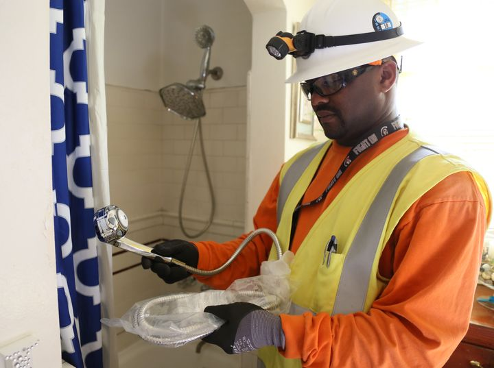 A union pre-apprenticeship program participant working with the Los Angeles Department of Water and Power installs a more ene