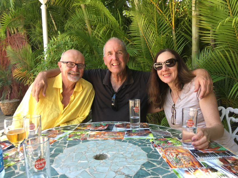 Author Steve Chapple, Cuban-American attorney Manuel Ramos, and Ines Salgado Chapple finish off the flan at El Bacura outside