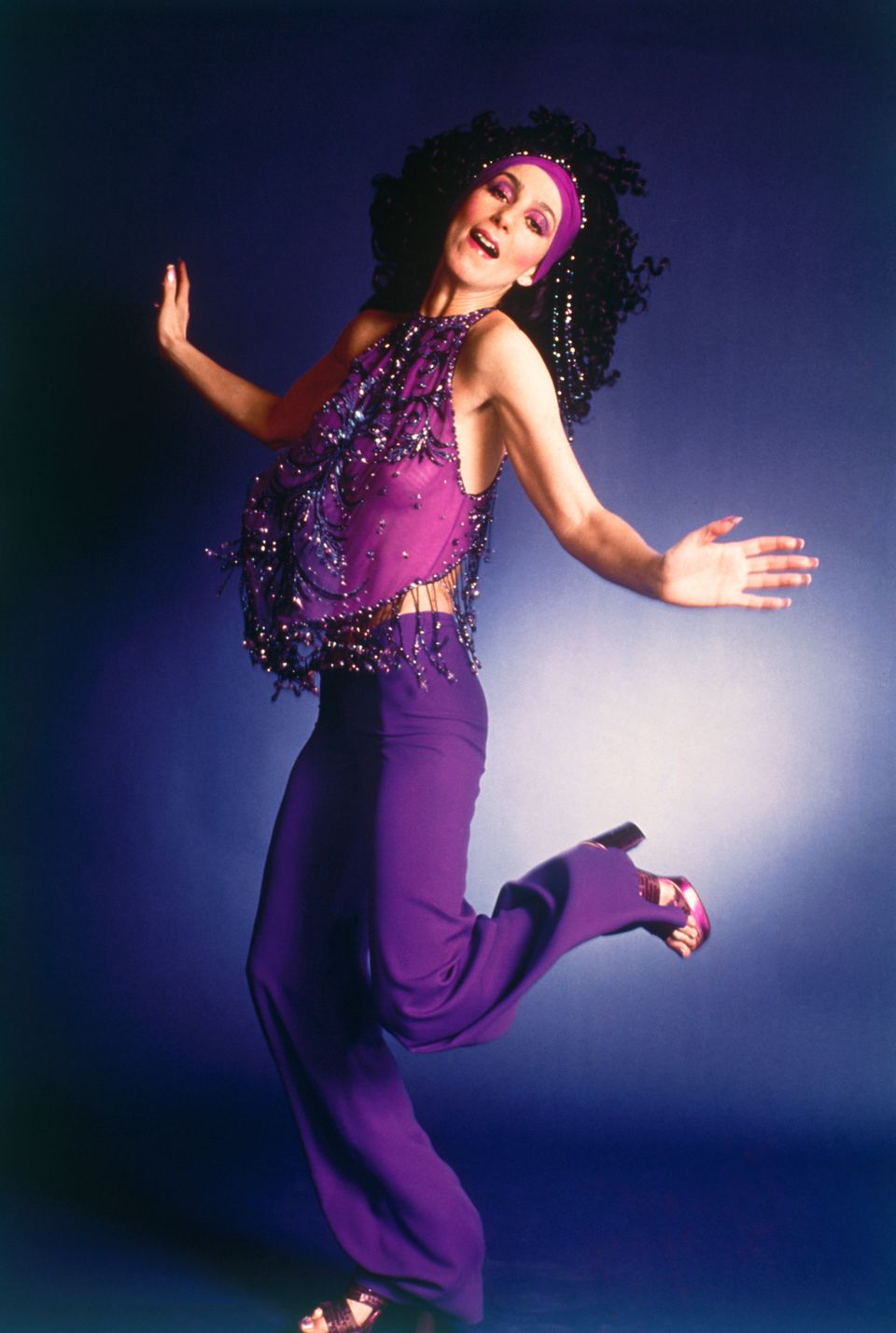 Cher Bono wearing purple pants outfit.