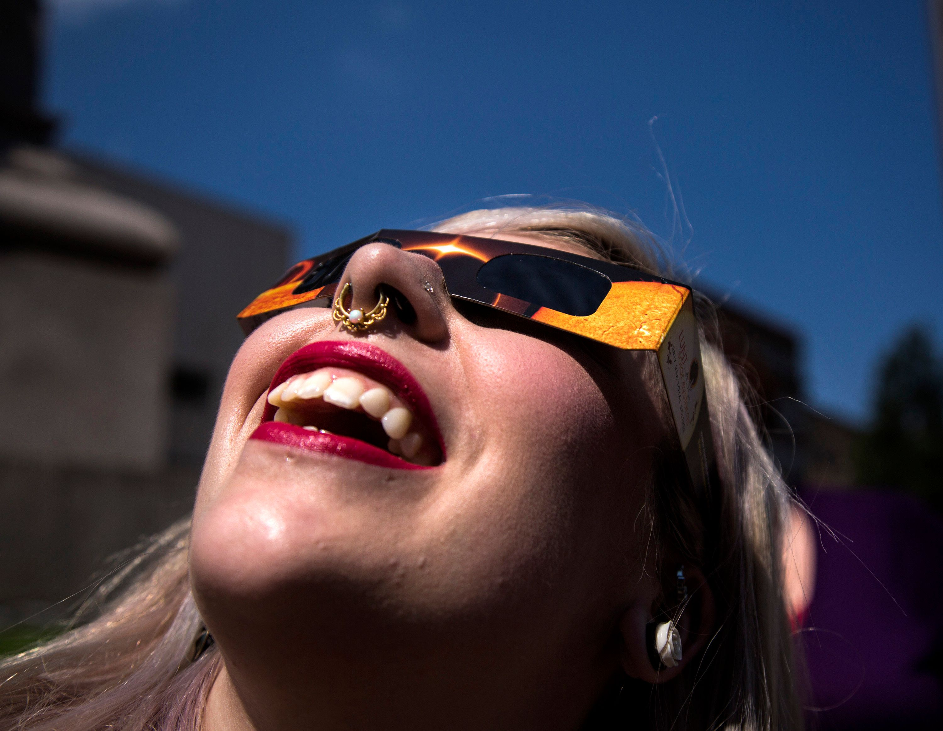 PORTLAND, ME - AUGUST 21: Angela Dispirito of Ware, N.H. watches the eclipse through solar glasses at Monument Square on Monday, August 21, 2017. (Staff photo by Derek Davis/Portland Press Herald via Getty Images)