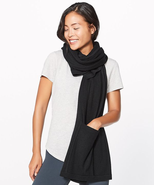 When traveling solo, try and find as many multipurpose items as possible, like this scarf with its pockets and wrap around de