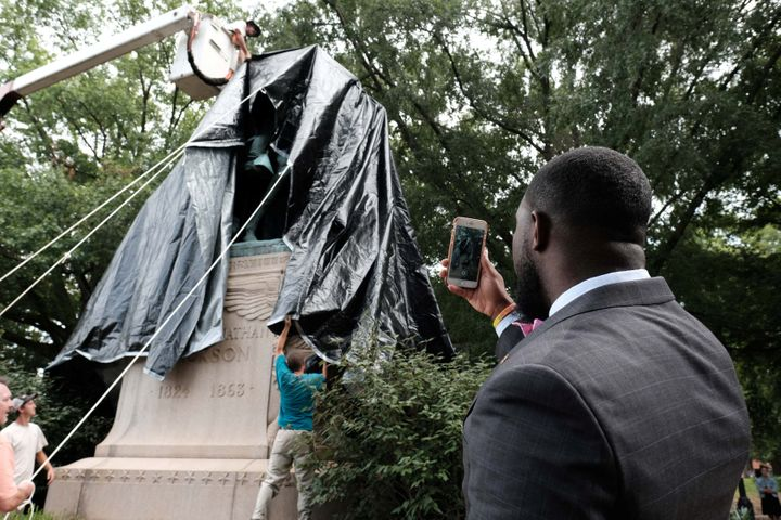 "The statue of Confederate General Thomas ""Stonewall"" Jackson is shown covered in black tarp as Dr. Wes Bellamy, the vice mayo"
