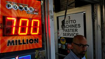 A screen displays the value of the Powerball jackpot at a store in New York City, U.S., August 22, 2017. REUTERS/Brendan McDermid